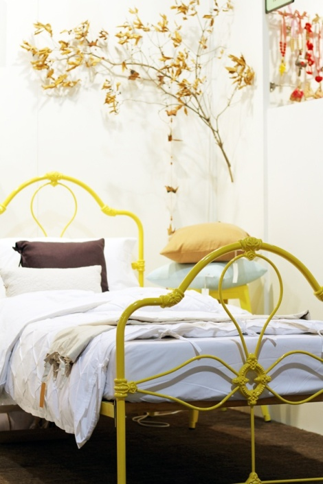yellow metal bed frame
